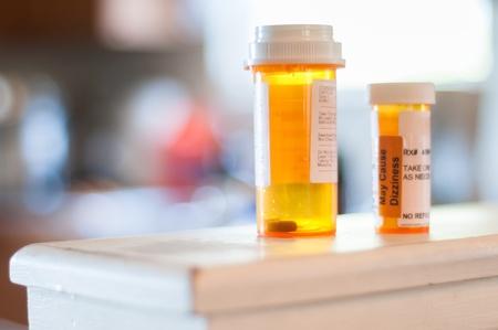 painkiller: Medicine pill bottles nearly empty, needing refills soon.