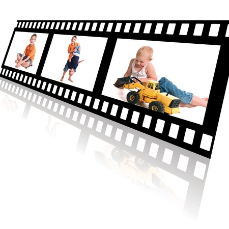 Film strip with reflection on a white background showing male siblings playing photo