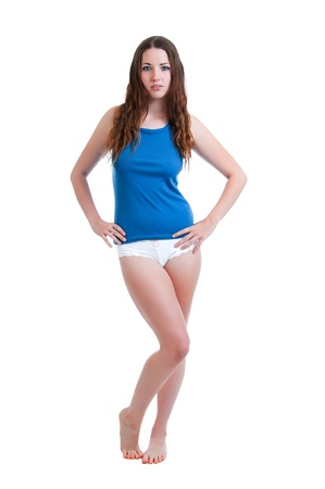 thong woman: Pretty young brunette woman posed in white panties and a blue camisole isolated against a white background