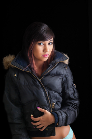 parka: Pretty young woman wearing a warm winter coat over her lingerie Stock Photo
