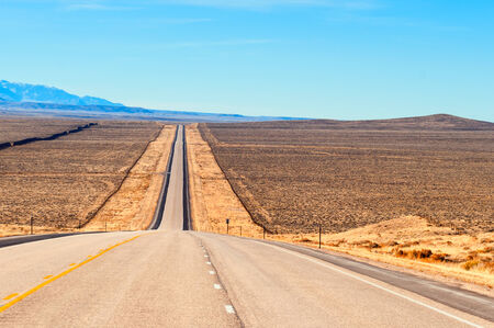 wyoming: Long straight strech of US highway 287 through ranch country in central Wyoming, USA  Stock Photo