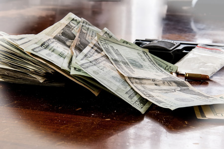 illegal drug: Stack of money on a table at an illegal drug transaction