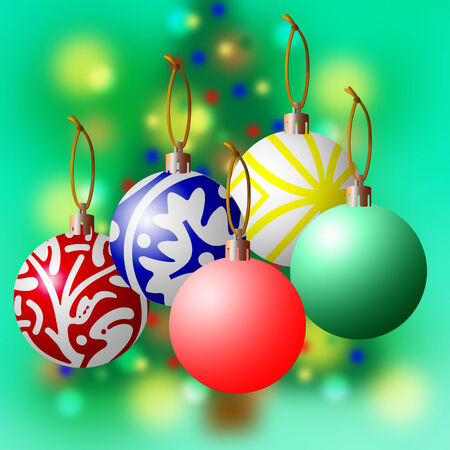 Decorative Christmas balls suspended in front of a blurred tree and green background.