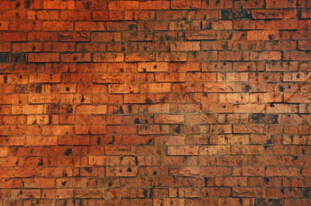 bricks background: Wall made of brown colored bricks for a background with lots of copyspace Stock Photo