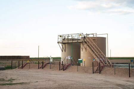 Small tank battery for storage near a stripper oil well in central Colorado, USA 写真素材