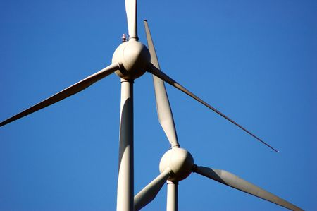 two windmills over a beautiful blue sky photo