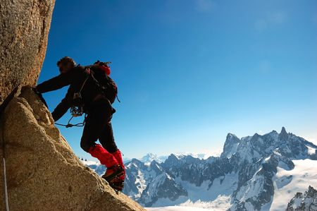backlights: Male climber, Rock-climbing sport, horizontal orientation, day light; Mont Blanc massif