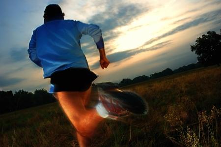 Pan blur of runners legs during a cross country running.