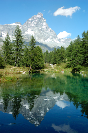 matterhorn: View of the south face of Matterhorn reflected in a small lake, Italy
