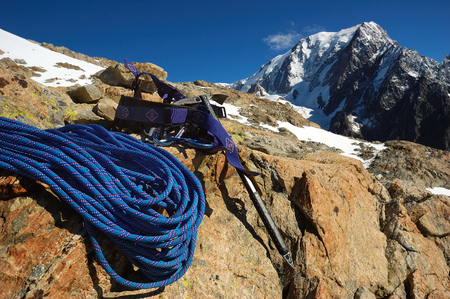 ice axe: Climbing Equipment (ice axe and rope), west face of Mont Blanc, Italy.  Stock Photo