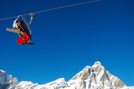 Chair-lift; on background the Matterhorn; high mountain, winter ski area, Zermatt; Swiss. photo