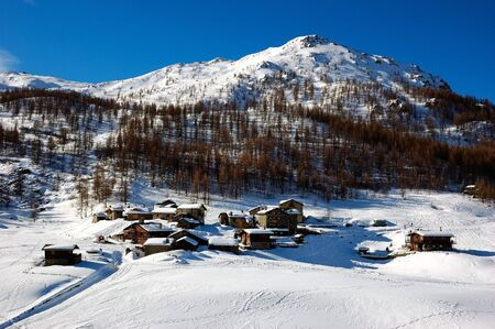 A little mountain village covered by snow, winter season photo