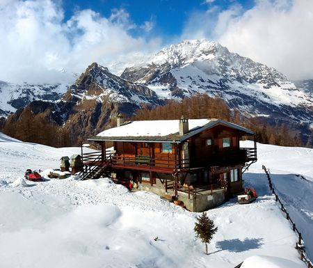 A mountain lodge covered by snow, winter season photo