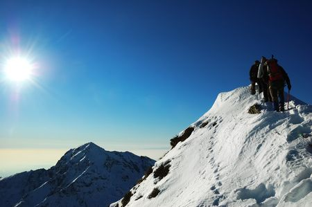 Group of mountaineers climbing a mountain Ridge, west Alps