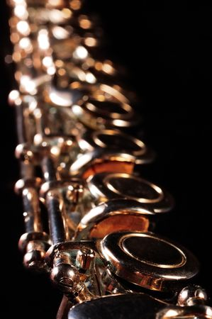 flutes: Detail of a Western concert flute, black background                  Stock Photo