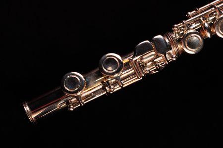 flute key: Detail of a Western concert flute, black background                  Stock Photo