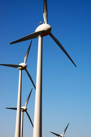 eolic: Eolic power generator: windmills over blue sky