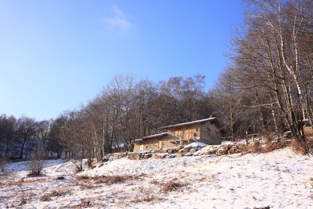 Small country-house under construction;winter scenic photo