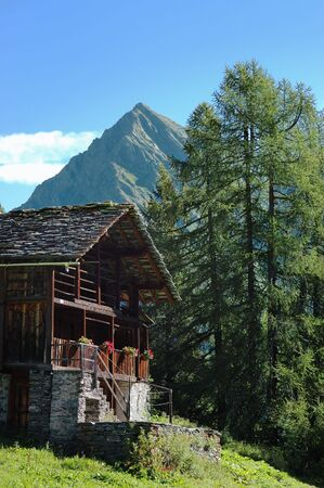 Tipical rural mountain wooden house Walser, Italy-Swiss border. photo