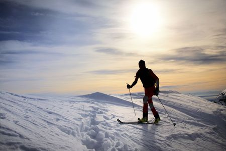 backlite: Male backcountry skier; backlite; italian alps Stock Photo