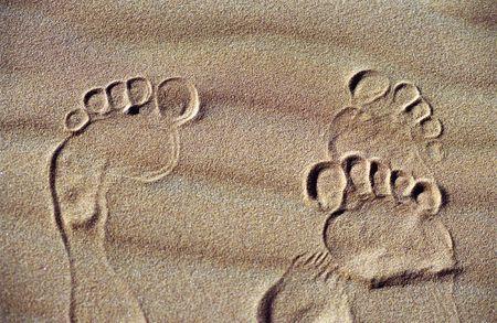 footprints on the sand of desert dunes, sahara, Maroc, Africa. photo