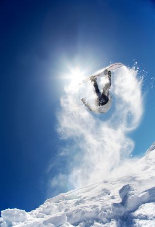 to ski: Snowboarder launching off a jump; La Thuile , Aosta, Italy.