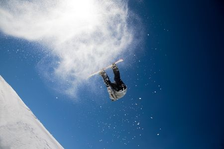 aosta: Snowboarder launching off a jump; La Thuile , Aosta, Italy.