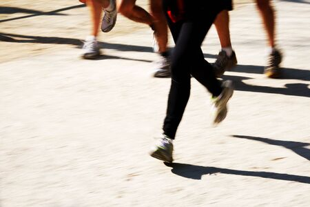 panning: Runners legs with panning blur. horizontal frame.