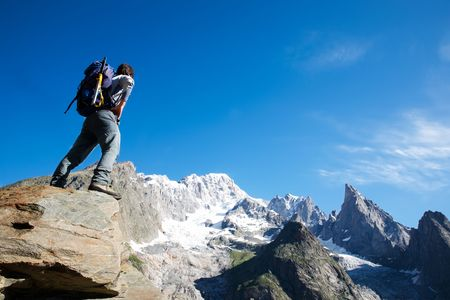 blanc: Young male trekker looking at Mont Blanc south face; Mont Blanc, italian side, Courmayeur, Italy.