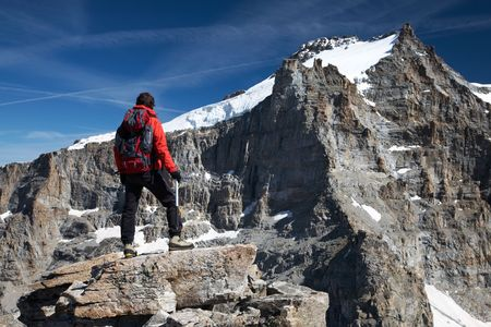 Young hiker enjoying the view over the beautiful landscape of Gran Paradiso peak (4046 mt), Italy photo