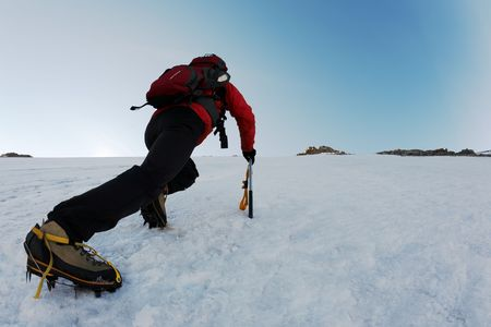 steep: Mountaineer climbing a steep route on a icy slope, italian Alps, Europe.