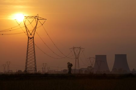 Power line of a nuclear power station; sunset.