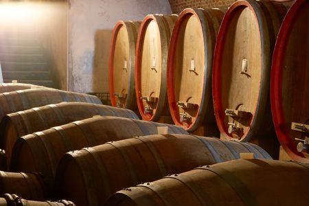 Large wine barrels in old wineyard cellar, Piemonte, Italy Standard-Bild