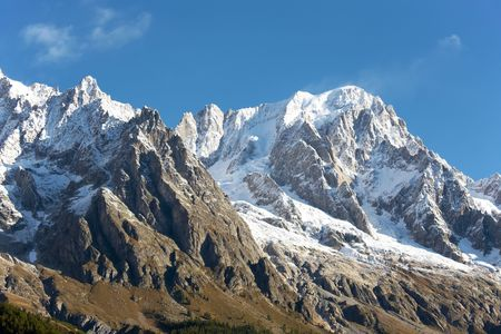 Summer view of snowcapped peaks in an alpine valley. Gran Jourasses (Mont Blanc massif), Val Veny, Courmayeur, Italy. photo