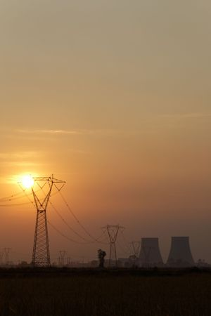 globalwarming: Power line of a nuclear power station; sunset.