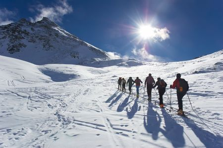 Group of backcountry skiers (ski touring), west alps, Europe. Standard-Bild