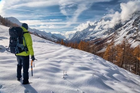 Exploration concept: a lonely hiker in the wilderness. Mont Blanc massif, Val Ferret, Courmayeur, Valle daosta, Italy.