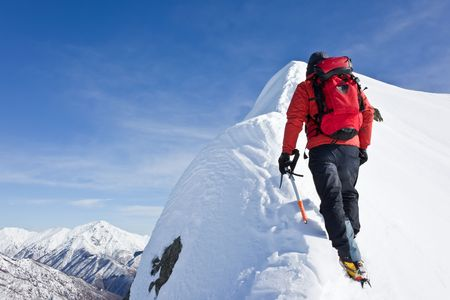 Climber on a snowy ridge, italian alps, Europe. Horizontal frame.