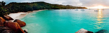 Panoramic view of a tropical beach at dawn. Anse Lazio, Praslin island, Seychelles, Indian Ocean.