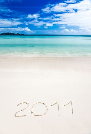 eleven: Year 2011 (two thousand and eleven) writenn in the sand of a tropical beach