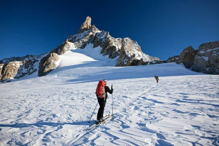 A group of backcountry skiers walks up to the Dent du Géant, Mont Blanc massif, Chamonix, west Alps, France, Europe.
