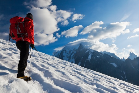 A male mountaineer walking uphill on a glacier. Mont Blanc, France. Stock Photo