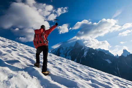 ice climbing: A male mountaineer walking uphill on a glacier. Mont Blanc, France. Stock Photo
