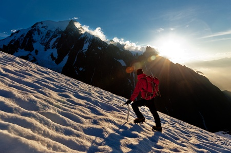 alpinist: A male mountaineer walking uphill on a glacier. Mont Blanc, France. Stock Photo