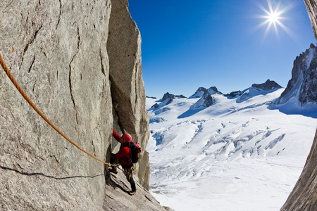 massif: A male young climber along a pitch on the south face of Mont Blanc massif. Petit Capucin, Mont Blanc, France.