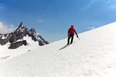 A male mountaineer on the way for reach the summit. Dent du Geant, Mont Blanc, Chamonix, France. photo