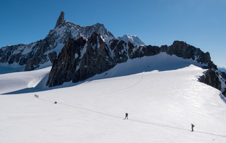 massif: A group of mountaineers that aim to conquest the Dent du Geant peak  in background   Mont Blanc massif, Chamonix, France, Europe  Stock Photo