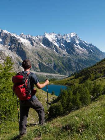 veny: Hiker admiring mountain landscape in Val Veny, Mont Blanc, Courmayer, Italy, Europe  Stock Photo