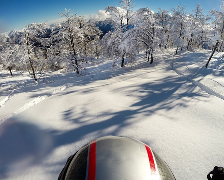 Skiing in fresh snow. POV using action cam on the helmet. Bielmonte, Italy, Europe. Stock Photo