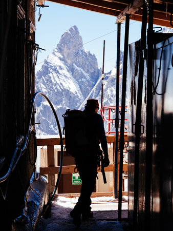 noire: Mountaineer in a alpine hut. In background Aiguille Noire, Mont Blanc, Italy. Stock Photo